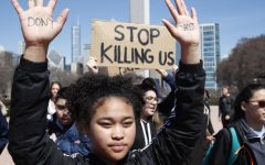CHICAGO, IL - APRIL 20: A student holds up her hands while taking part in National School Walkout Day to protest school violence on April 20, 2018 in Chicago, Illinois. Students from around the nation joined in the walkout against gun violence on the 19th anniversary of the shooting at Columbine High School (Photo by Jim Young/Getty Images)