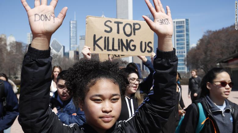 CHICAGO%2C+IL+-+APRIL+20%3A+A+student+holds+up+her+hands+while+taking+part+in+National+School+Walkout+Day+to+protest+school+violence+on+April+20%2C+2018+in+Chicago%2C+Illinois.+Students+from+around+the+nation+joined+in+the+walkout+against+gun+violence+on+the+19th+anniversary+of+the+shooting+at+Columbine+High+School+%28Photo+by+Jim+Young%2FGetty+Images%29