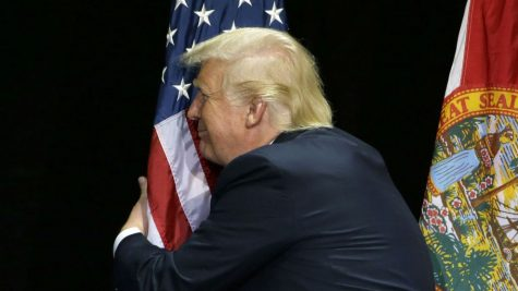 Amazing picture of our president giving a warm hug to out national flag.