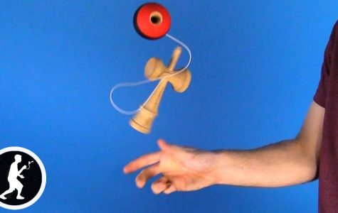"This is an image of the kendama trick ""ken flip."""