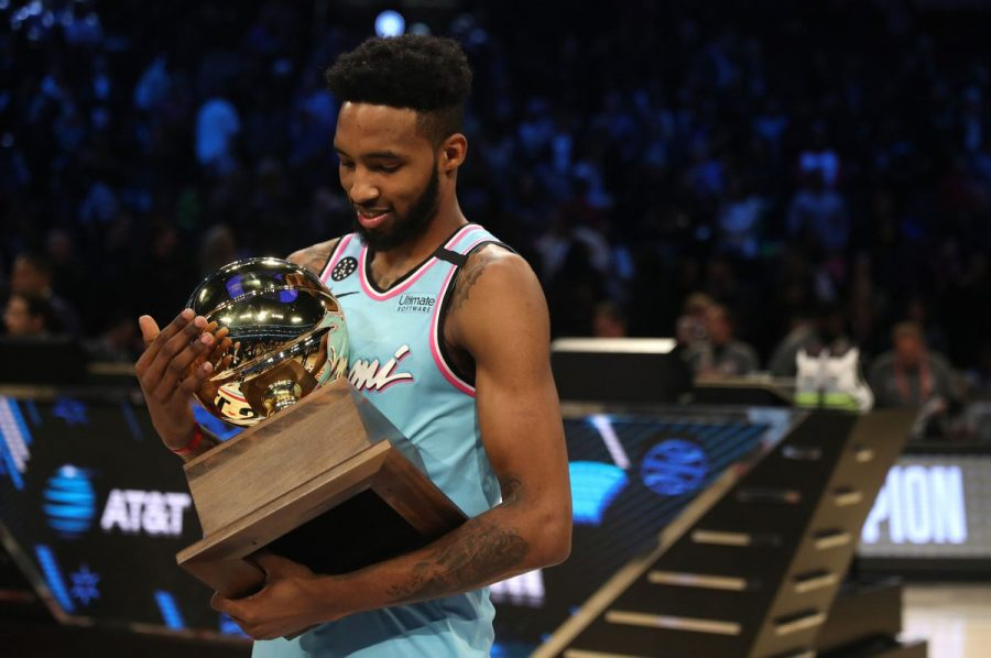 (Photo Courtesty of Sun Sentinel) Derrick Jones Jr. holds the Dunk Contest trophy after his 1 point victory over Aaron Gordon.