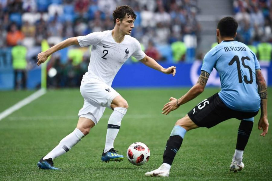 France's defender Benjamin Pavard (L) vies with Uruguay's midfielder Matias Vecino during the Russia 2018 World Cup quarter-final football match between Uruguay and France at the Nizhny Novgorod Stadium in Nizhny Novgorod on July 6, 2018. / AFP PHOTO / FRANCK FIFE / RESTRICTED TO EDITORIAL USE - NO MOBILE PUSH ALERTS/DOWNLOADSFRANCK FIFE/AFP/Getty Images