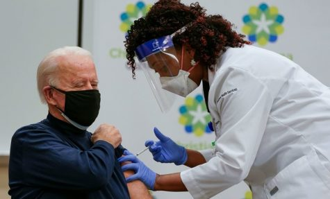 US President-elect Joe Biden receives a Covid-19 vaccination from Tabe Masa, Nurse Practitioner and Head of Employee Health Services, at the Christiana Care campus in Newark, Delaware on December 21, 2020. (Photo by Alex Edelman / AFP) (Photo by ALEX EDELMAN/AFP via Getty Images)